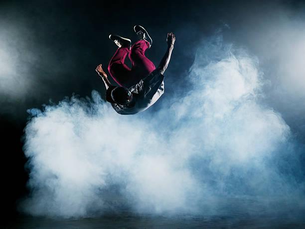 Dancer leaping through smoke