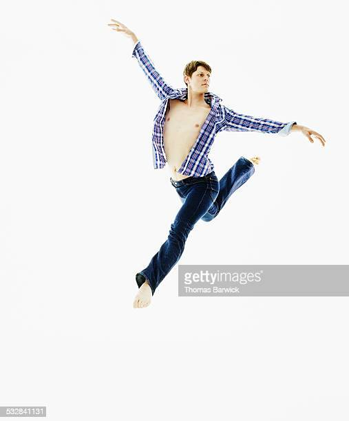 Dancer leaping with arms and legs outstretched