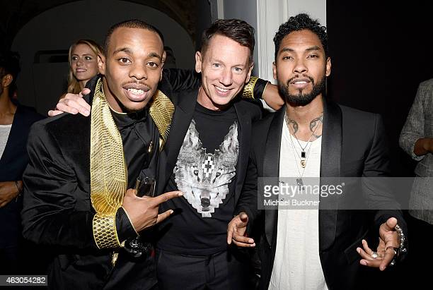 Dancer Lil Buck GQ EditorinChief Jim Nelson and recording artist Miguel attend GQ and Giorgio Armani Grammys After Party at Hollywood Athletic Club...