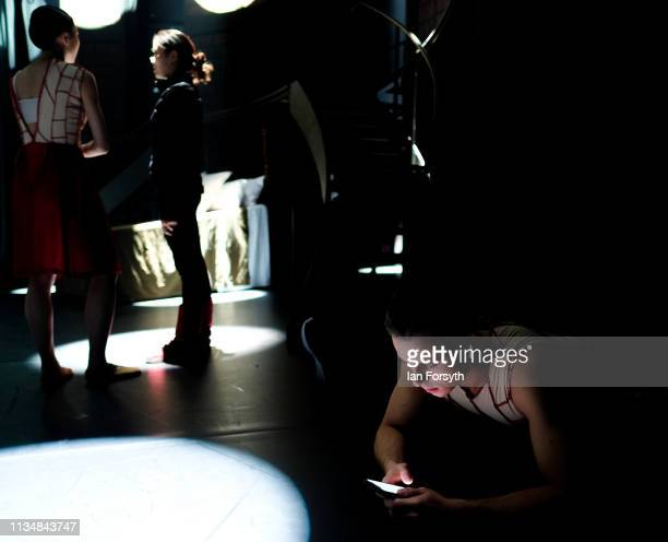 A dancer listens to music as he stretches on stage minutes before the curtain goes up for the World Premier of Northern Ballet's performance of...