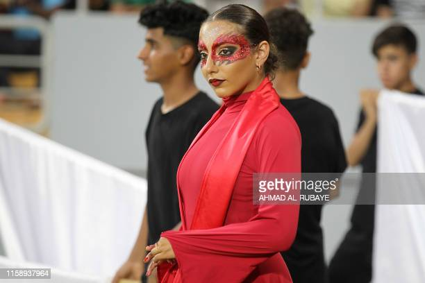 TOPSHOT A dancer looks on after performing during a ceremony ahead of a football match between Iraq and Lebanon in the West Asian Championship at the...