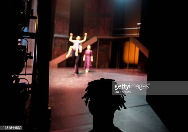 A dancer looks on from the wings as he waits to enter the stage during the World Premier of Northern Ballet's performance of 'Victoria' at Leeds...