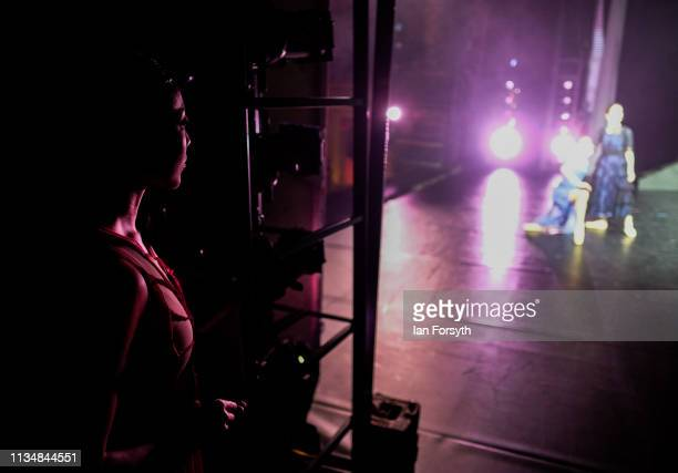 A dancer looks on from the wings as she waits to enter the stage during the World Premier of Northern Ballet's performance of 'Victoria' at Leeds...