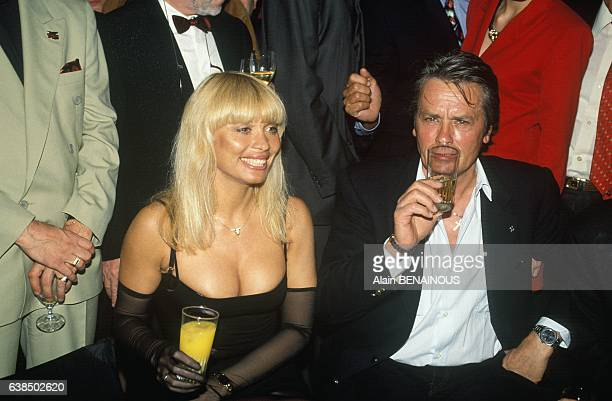 Dancer Lova Moor and Alain Delon at the party for the 40th anniversary of the cabaret Crazy Horse in Paris, France, on June 5, 1991.