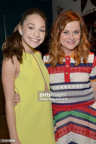 Dancer Maddie Ziegler and actress Amy Poehler attend Nickelodeon's 2016 Kids' Choice Awards at The Forum on March 12 2016 in Inglewood California