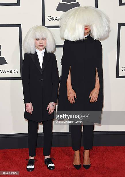 Dancer Maddie Ziegler and singer/songwriter Sia arrive at the 57th Annual GRAMMY Awards at Staples Center on February 8 2015 in Los Angeles California