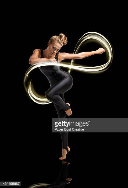 Dancer making light motion forming infinity