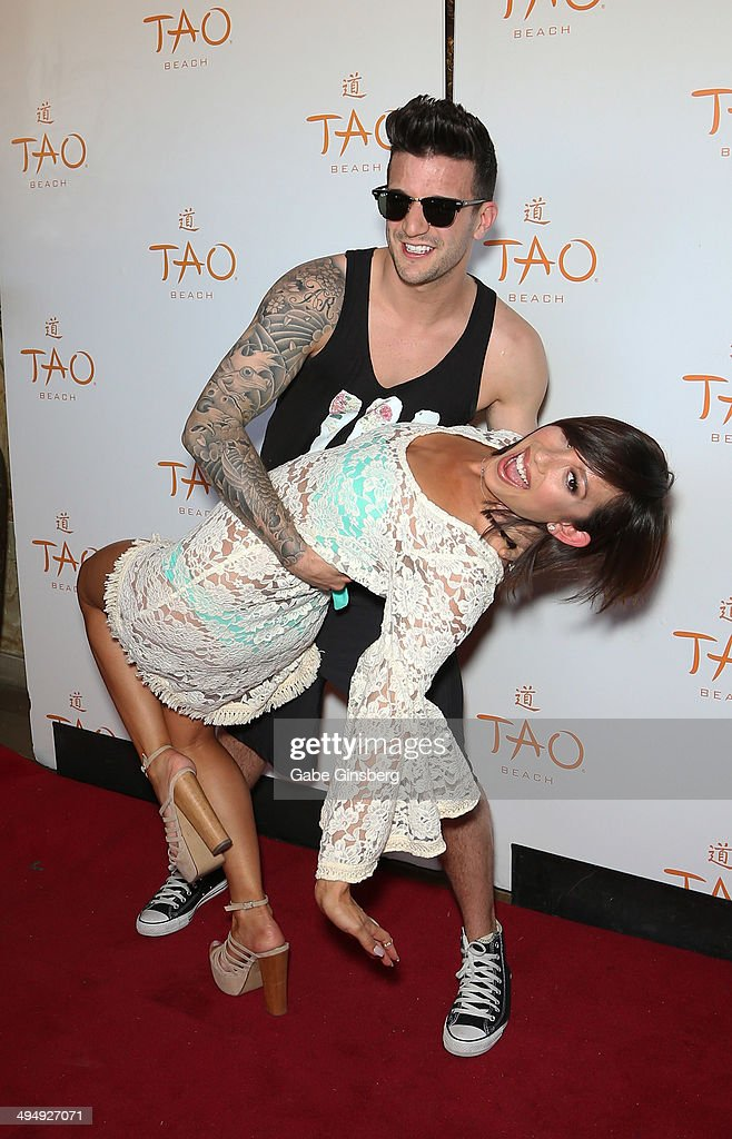 Dancer Mark Ballas (L) and dancer/model Cheryl Burke joke around as they arrive at a birthday celebration hosted by Cheryl Burke at the Tao Beach at The Venetian Las Vegas on May 31, 2014 in Las Vegas, Nevada.