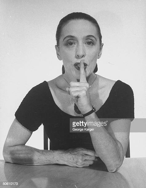 Dancer Martha Graham placing index finger on lips as Miss Hush on radio show Truth or Consequences