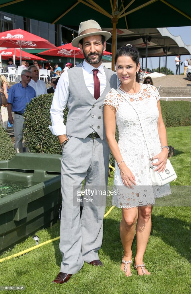 Dancer Massimo Senato and German actress Mariella Ahrens during the Audi Ascot Race Day (Renntag) 2018 on August 19, 2018 in Hanover, Germany.
