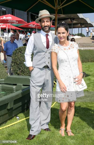 Dancer Massimo Senato and German actress Mariella Ahrens during the Audi Ascot Race Day 2018 on August 19 2018 in Hanover Germany