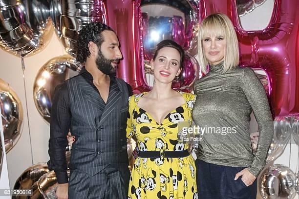 Dancer Massimo Senato fashion designer Lena Hoschek and german actress Monica Ivancan seen at the Lena Hoschek show during the MercedesBenz Fashion...