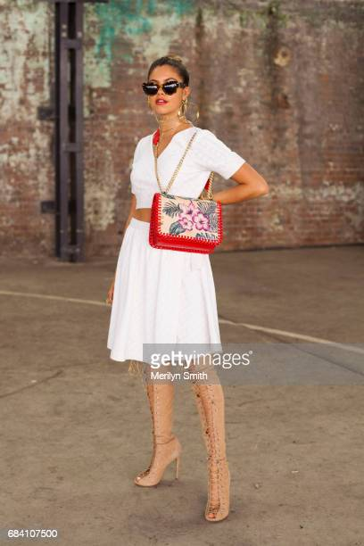 Dancer Model and Social Influencer Mimi Elashary wearing a She made me dress Hansen and Gretel bag Tony Bianco shoes Pamela Love and Maniamania...