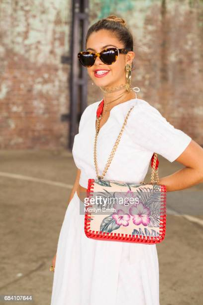 Dancer Model and Social Influencer Mimi Elashary wearing a She made me dress Hansen and Gretel bag Pamela Love and Maniamania jewellery and Lucy Folk...