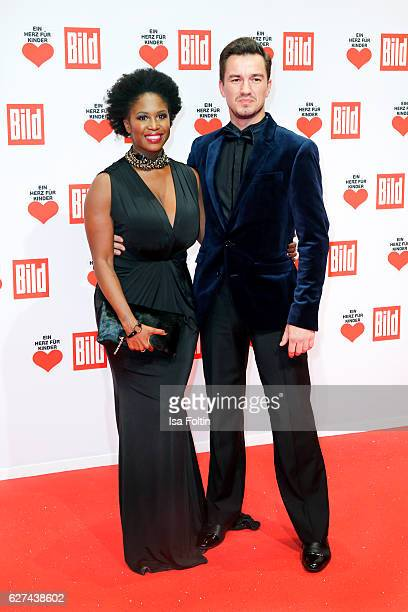 Dancer Motsi Mabuse and friend attend the Ein Herz Fuer Kinder gala on December 3, 2016 in Berlin, Germany.