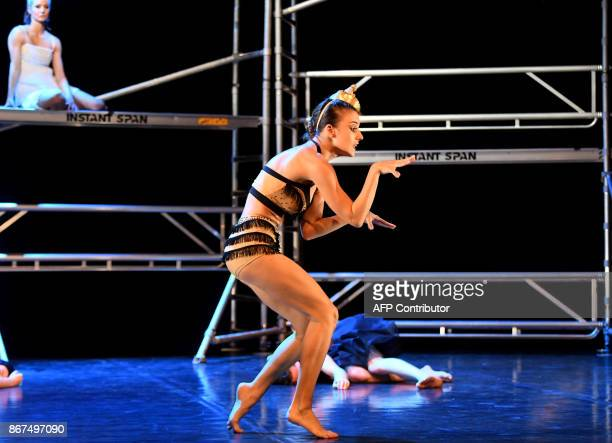 Dancer of a Hungarian contemporary group with classical ballet basics the 'Kulcsar Noemi Tellabor' group Kitti Hajszan performs on the stage of the...