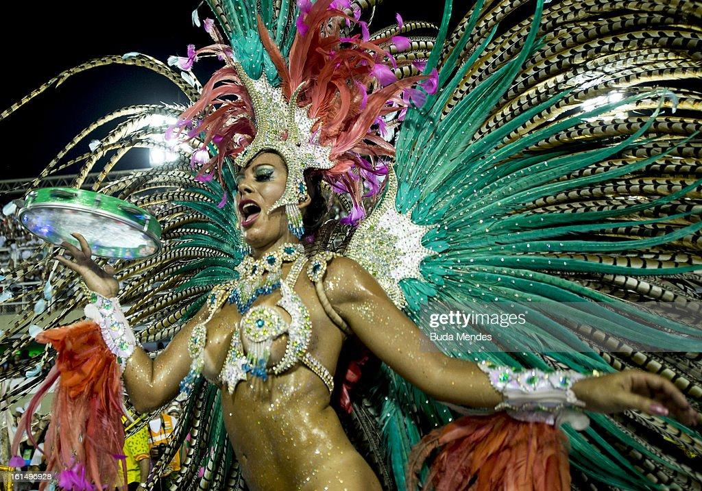 A dancer of Mangueira Samba School performs during the parade themed on Cuiaba, capital city of Mato Grosso at Sambodrome Sapucai on February 11, 2013 in Rio de Janeiro, Brazil.