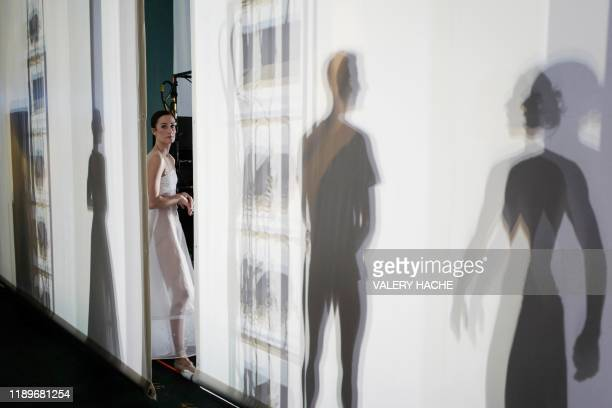 A dancer of the MonteCarlo ballet looks on during the rehearsal of the ballet show CoppeliA a creation by French dancer and choreographer...