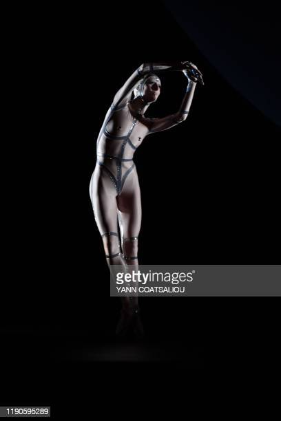 A dancer of the MonteCarlo ballet performs in CoppeliA a creation by French choreographer JeanChristophe Maillot on December 26 in Monaco The show...