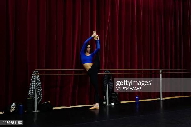 A dancer of the MonteCarlo ballet warms up in a room in the backstage during a class as part of the rehearsal of the ballet show CoppeliA a creation...