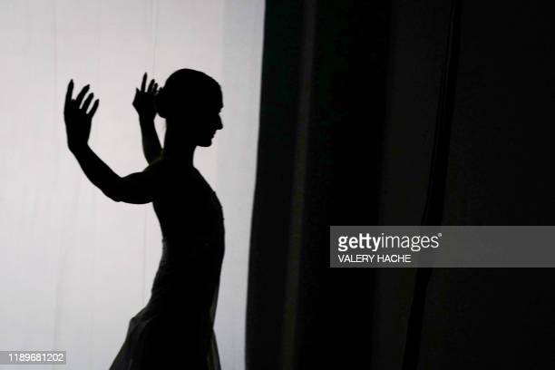 TOPSHOT A dancer of the MonteCarlo ballet warmsup in the backstage during the rehearsal of the ballet show CoppeliA a creation by French dancer and...
