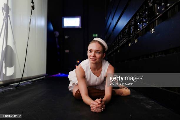 A dancer of the MonteCarlo ballet warmsup in the backstage during the rehearsal of the ballet show CoppeliA a creation by French dancer and...