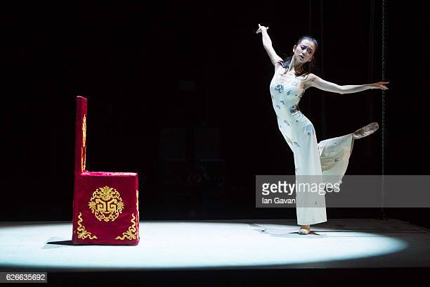 A dancer of the National Ballet of China performs on stage during a dress rehearsal of 'The Peony Pavilion' at Sadlers Wells Theatre on November 29...