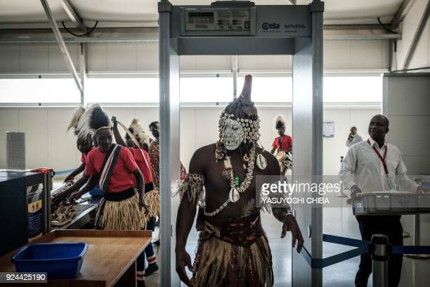 A dancer passes through a security checkpoint at the Jomo Kenyatta International airport on February 26 2018 in Nairobi prior to the arrival of the...