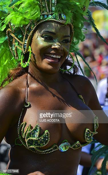 A dancer perfoms during the carnival parade in Barranquilla Colombia on February 09 2013 Barranquilla's Carnival a tradition cretaed by locals at the...