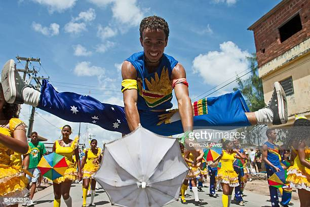 A dancer performs a frevo step during the Galo da Madrugada parade on February 21 2009 in central Recife Brazil Certified by the Guinness Book of...