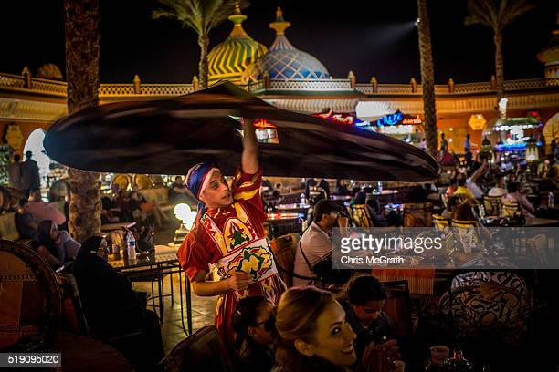 A dancer performs amongst a crowd of tourists at a tourist amusement park on April 3 2016 in Sharm El Sheikh Egypt Prior to the Arab Spring in 2011...