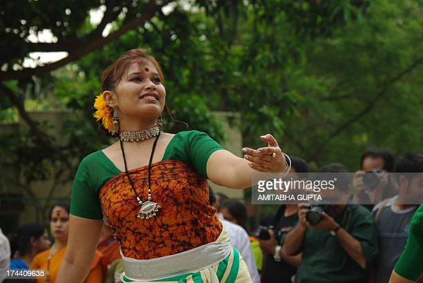 CONTENT] A dancer performs at the Basanta Utsav function of the Hindus at Golfgreen Kolkata with photographers in the background