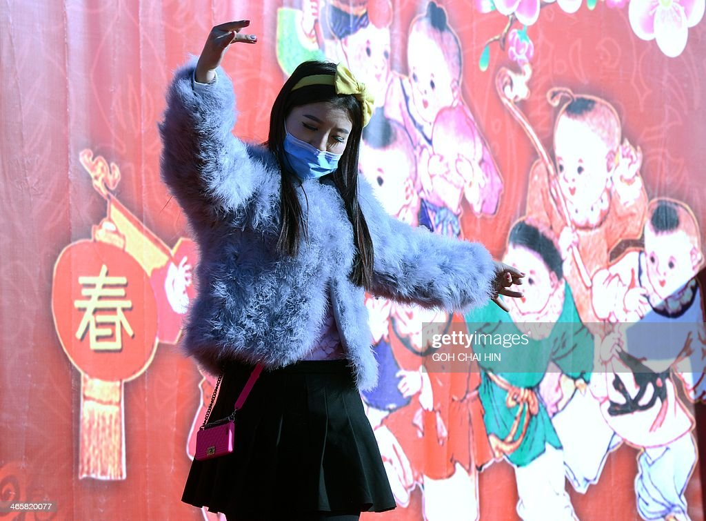 A dancer performs at the Ditan park temple fair in Beijing on January 30, 2014, on the eve of the Lunar New Year. Over a billion Chinese in China and millions more all over the world will be celebrating the Lunar New Year, known as the Spring Festival in China.