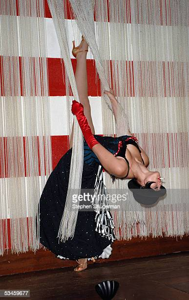 A dancer performs burlesque at Svedka Vodka's Erotica Reading Series at Ivan Kane's Forty Deuce on August 24 2005 in Hollywood California