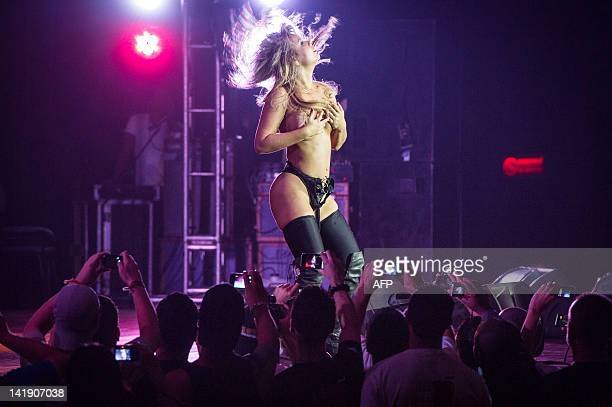 A dancer performs during a strip dance contest during the Erotika Fair in Sao Paulo Brazil on March 25 2012 The annual fair of products and services...