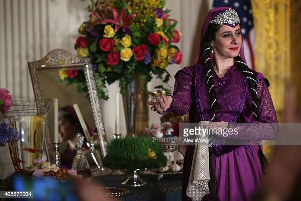 Dancer performs during an event to mark Nowruz, a holiday that is celebrated by over 300 million people in diverse ethnic and religious communities...