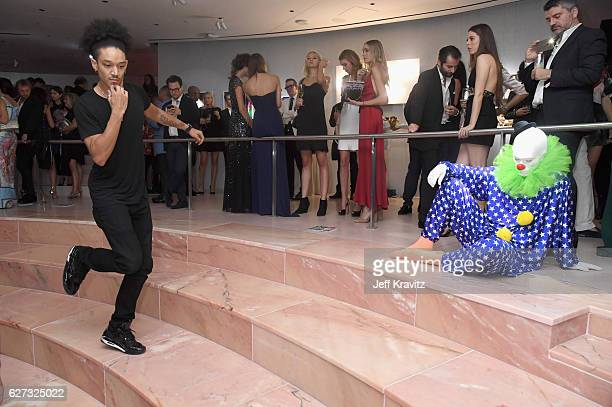 A dancer performs during Madonna presents An Evening of Music Art Mischief and Performance to benefit Raising Malawi at Faena Forum on December 2...