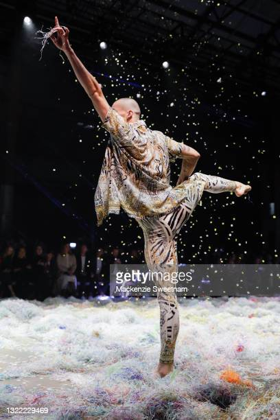 Dancer performs during the Afterpay's Future of Fashion show during Afterpay Australian Fashion Week 2021 Resort '22 Collections at Carriageworks on...