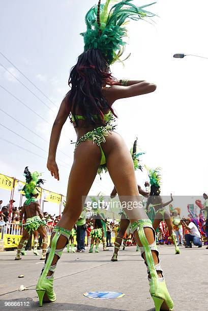 A dancer performs during the Carnival parade in Barranquilla Colombia on February 13 2010 AFP PHOTO/STR
