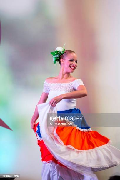 A dancer performs during the celebration event in which UNESCO recognized Merengue as an intangible heritage of humanity in Santo Domingo on August...