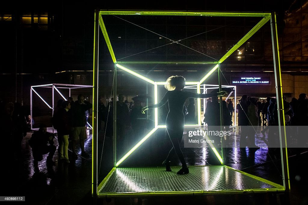 A dancer performs in the 'Dancing Cubes' installation by artists Vacek & Smid during the Signal light festival on October 15, 2015 in Prague, Czech Republic. Local and international artists present news in videomapping, site-specific projections, interactive and light installations in the streets of the city during four day festival.
