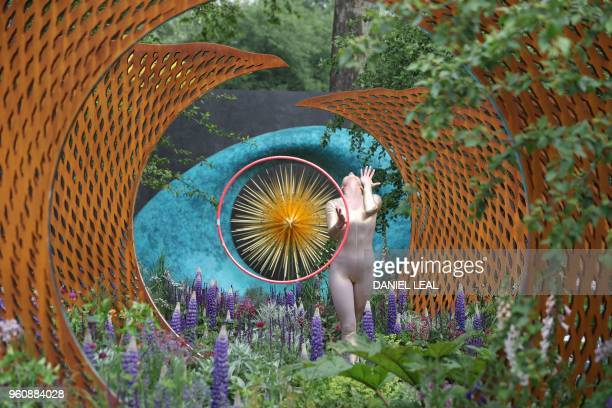 TOPSHOT A dancer performs in The David Harber and Savills Garden at the 2018 Chelsea Flower Show in London on May 21 2018 The Chelsea flower show...