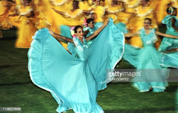A dancer performs in the opening ceremony of the Central American and Caribbean Games in the Pachencho Romero Stadium in Maraciabo Venezuela 08...