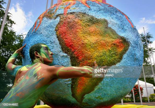 A dancer performs next to a globe during an antideforestration campign at the venue of the UN Climate Change Conference 2007 in Nusa Dua on Bali...
