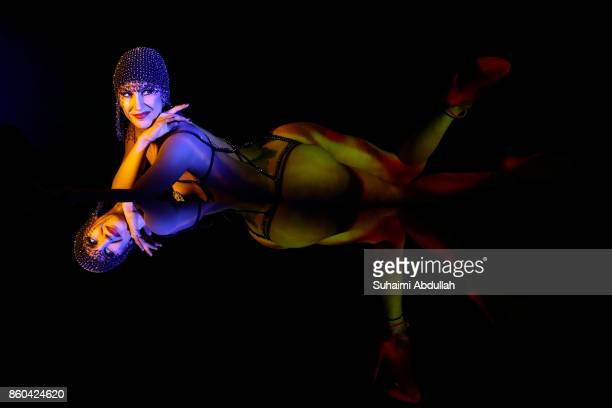 A dancer performs on stage during the Crazy Horse Paris 'Forever Crazy' Media Call at The MasterCard Theatres at Marina Bay Sands on October 11 2017...