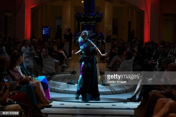 A dancer performs on the runway at the Anja Gockel show during the MercedesBenz Fashion Week Berlin Spring/Summer 2018 at Hotel Adlon on July 4 2017...