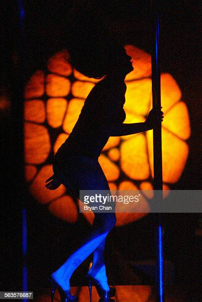 A dancer performs on the stage at the strip club Silver Reign in West LA As part of a broad new set of ordinances regulating various adult businesses...