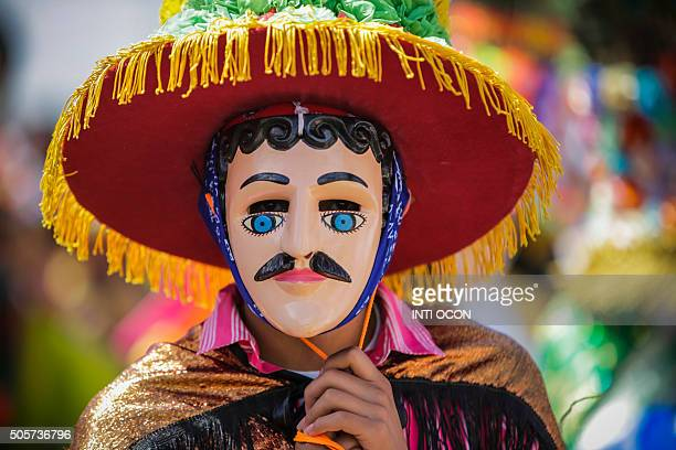 TOPSHOT A dancer performs traditional dances during San Sebastian festivity in Diriamba province of Carazo some 50 km south of Managua on January 19...