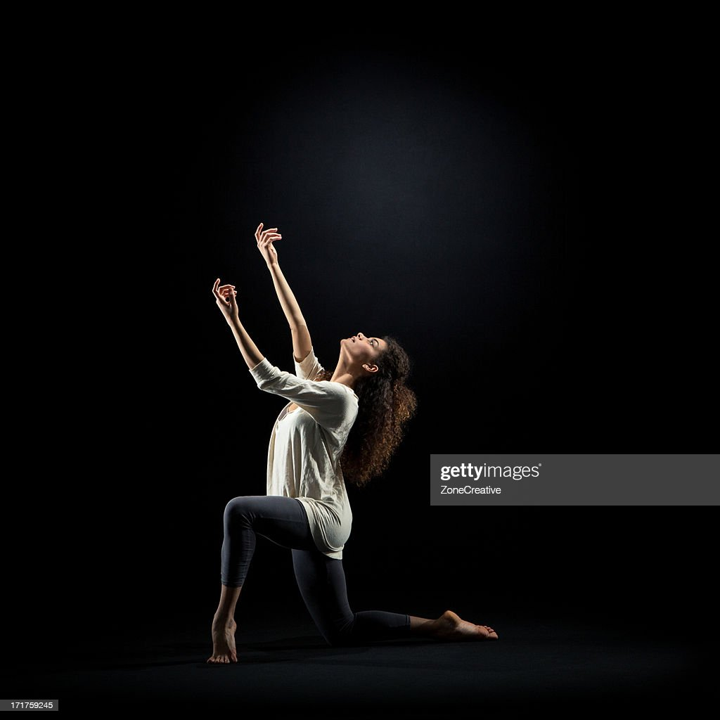 Dancer pose on black background : Stock Photo