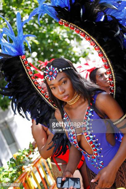 A dancer poses at the Red Bull Music Academy x Mangrove float at Notting Hill Carnival on August 28 2017 in London England